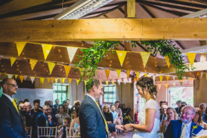 A marriage ceremony at the treehouse wedding venue in Beaulieu in Hampshire