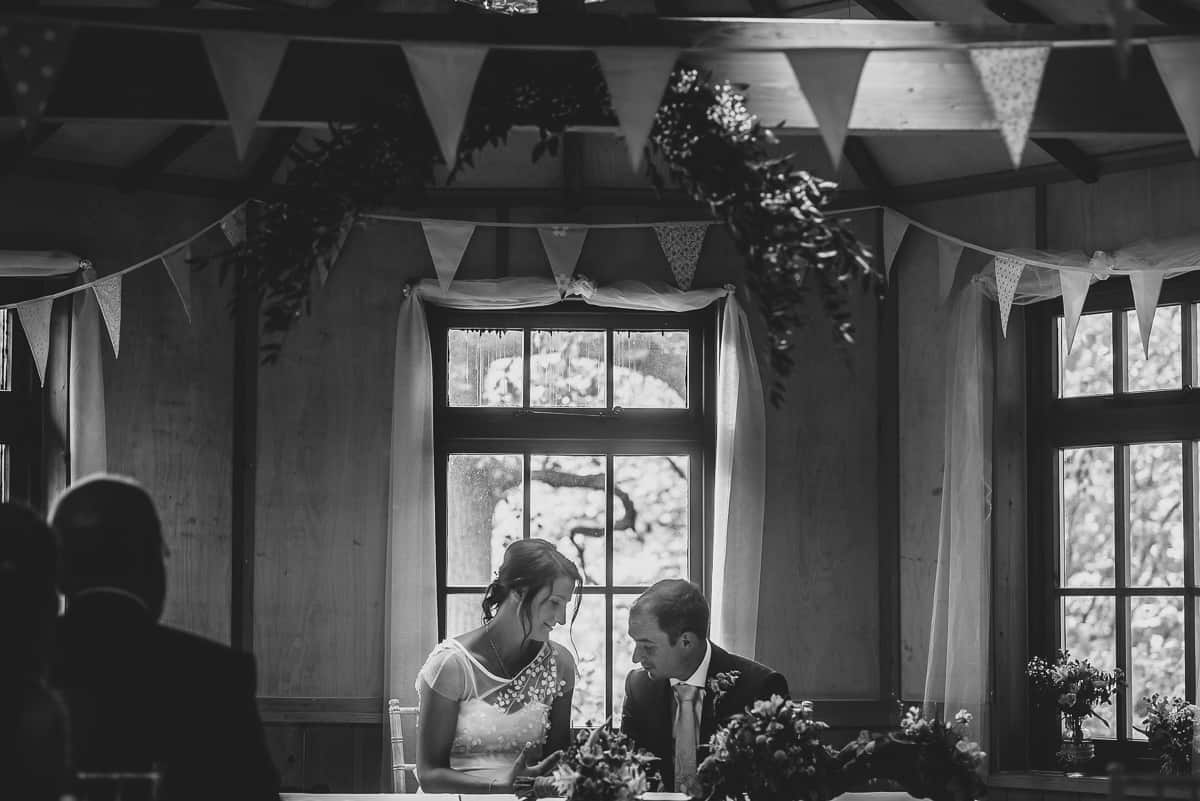 The Couple sign the register at their treehouse wedding