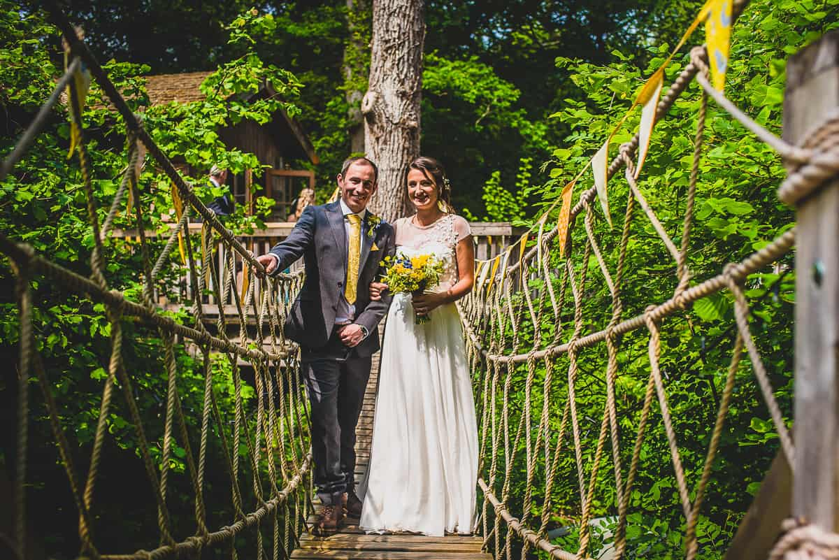 Couple on the ropbridge at the Treehouse wedding venue in the new forest
