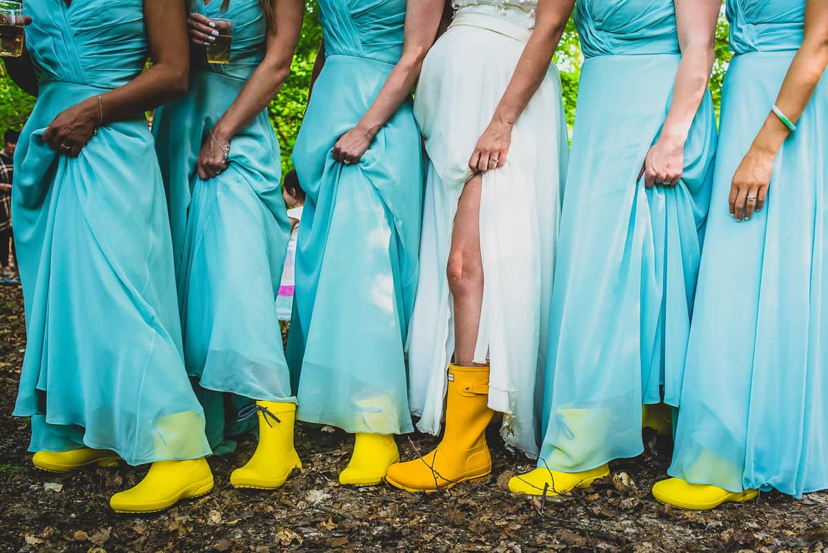 Bridesmaids show of their matching yellow wellies