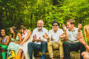 Guests enjoy songs around the bonfire at New Forest Wedding