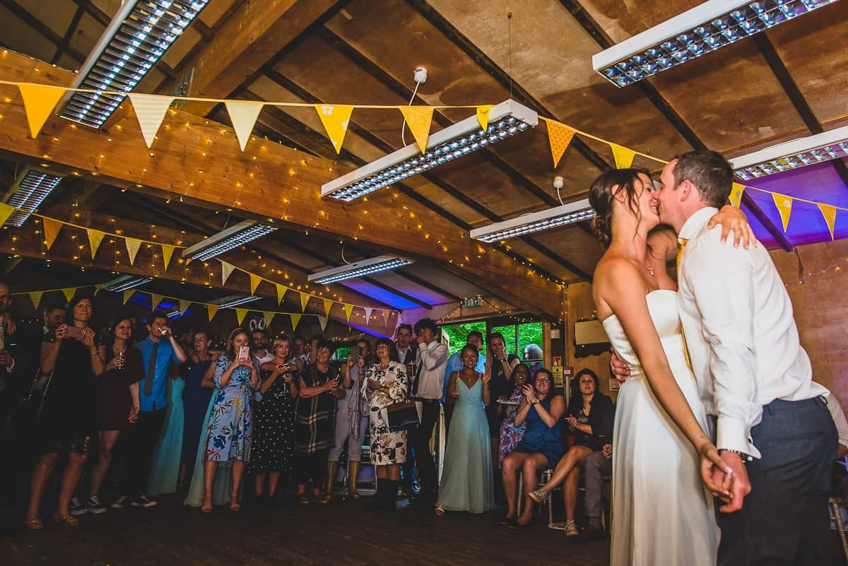 Couple enjoy their first dance at their treehouse wedding