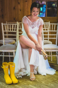 BRIDE PUTS ON A PAIR OF WELLIES