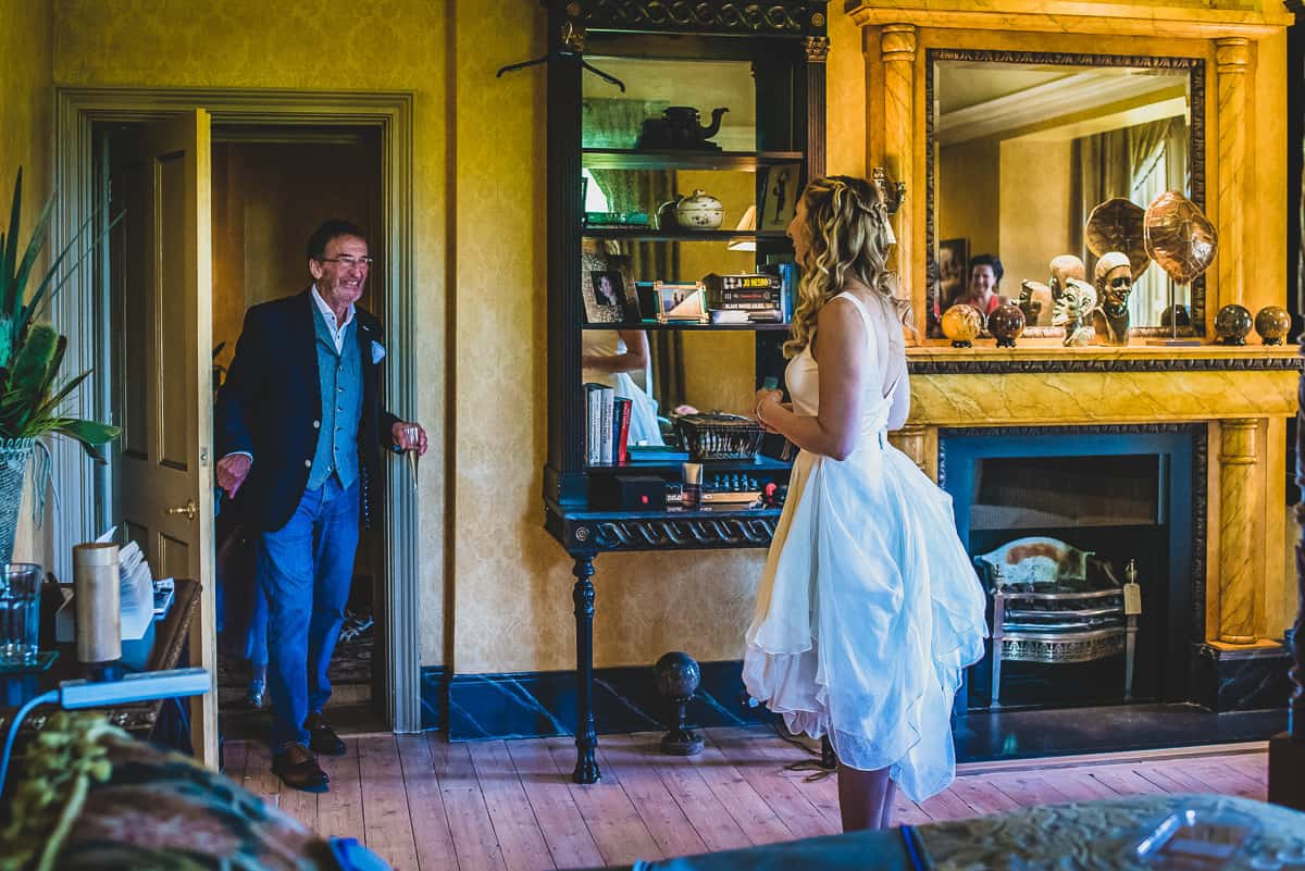 Bride's Dad sees her for first time at relaxed and informal wedding in Cambridge.