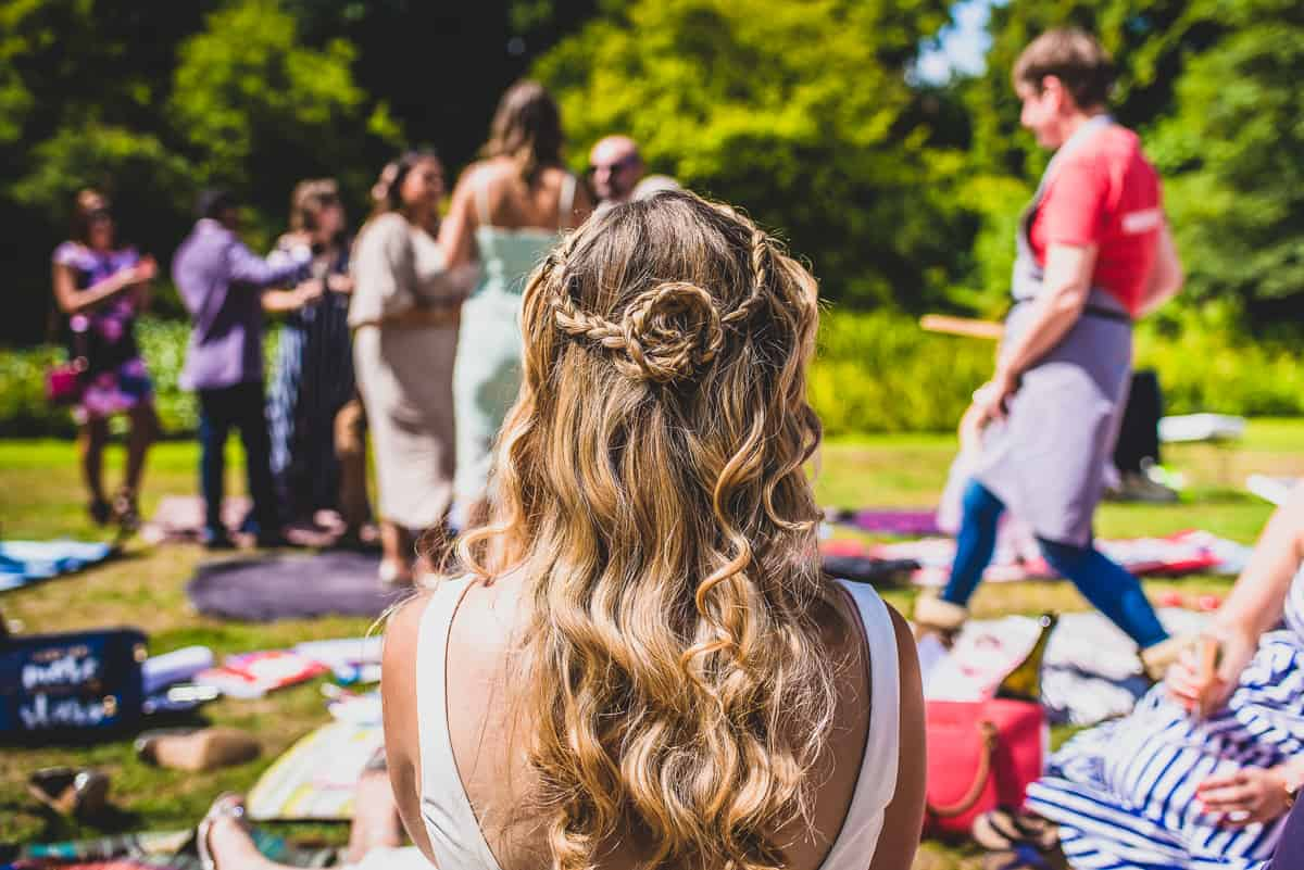 Details of the brides hair as she relaxes on the lawn.
