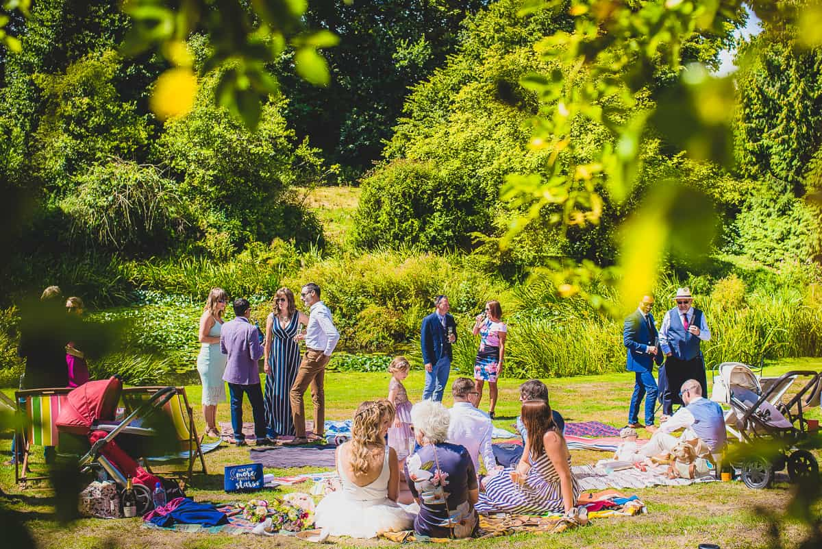 Wedding guest mingling on the lawn at Mears Ashby Hall.