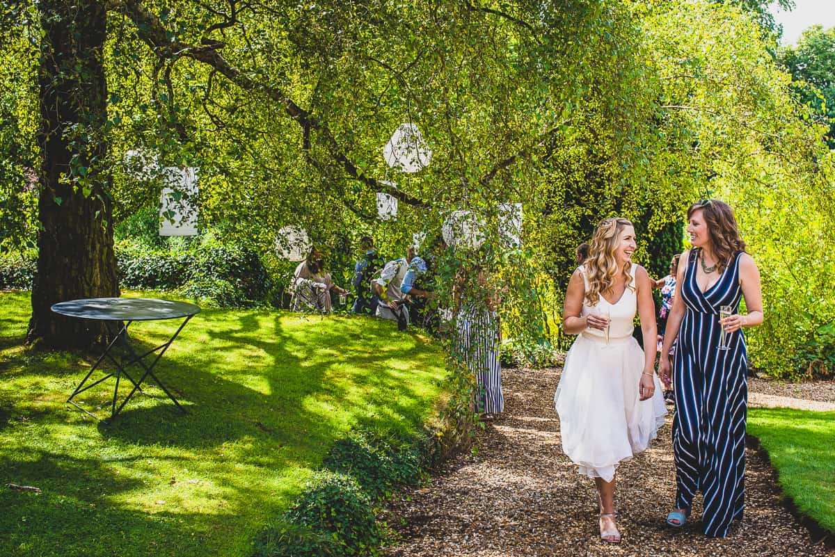 A bride and her friend go for a stroll at very relaxed and informal wedding in Cambridge.