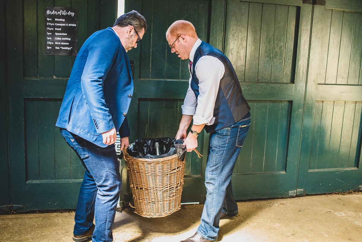 Guests carrying a basket full of booze and relaxed wedding reception.