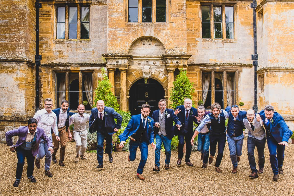Groom and male guests share the camera.