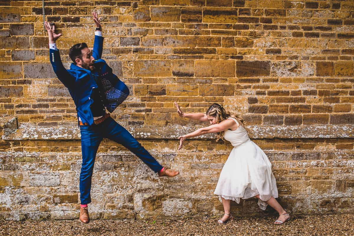 Bride and From recreated Streetfighter move for portrait at fun, informal and relaxed wedding in Cambridge