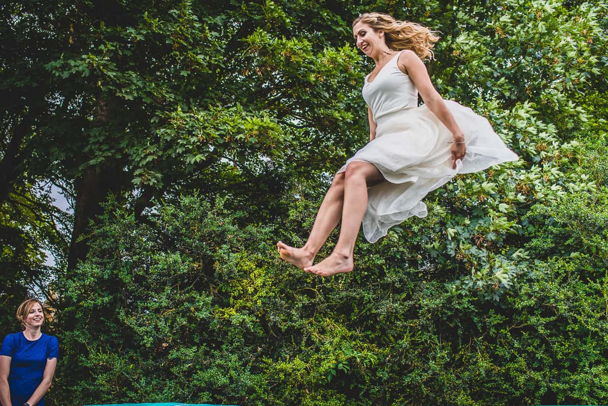Fun and relaxed wedding bride on a trampoline.