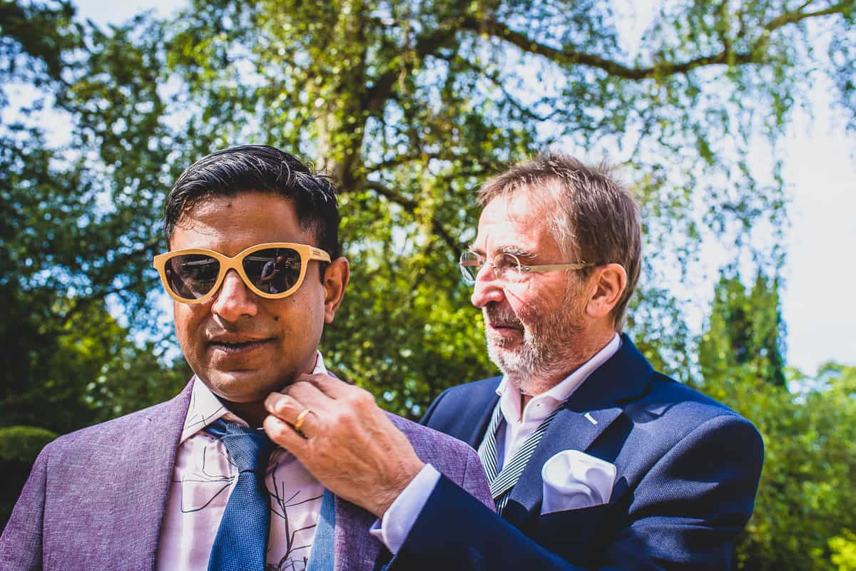 Gents preparing for an relaxing and informal wedding in Cambridgeshire