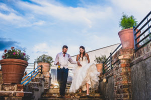 Bride and Groom on the steps outside The Old Hall Ely
