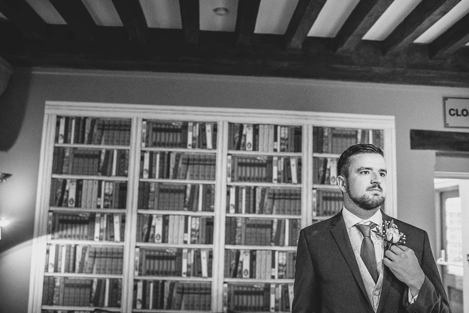 Nervous looking groom before wedding ceremony at The Old Hall in Ely