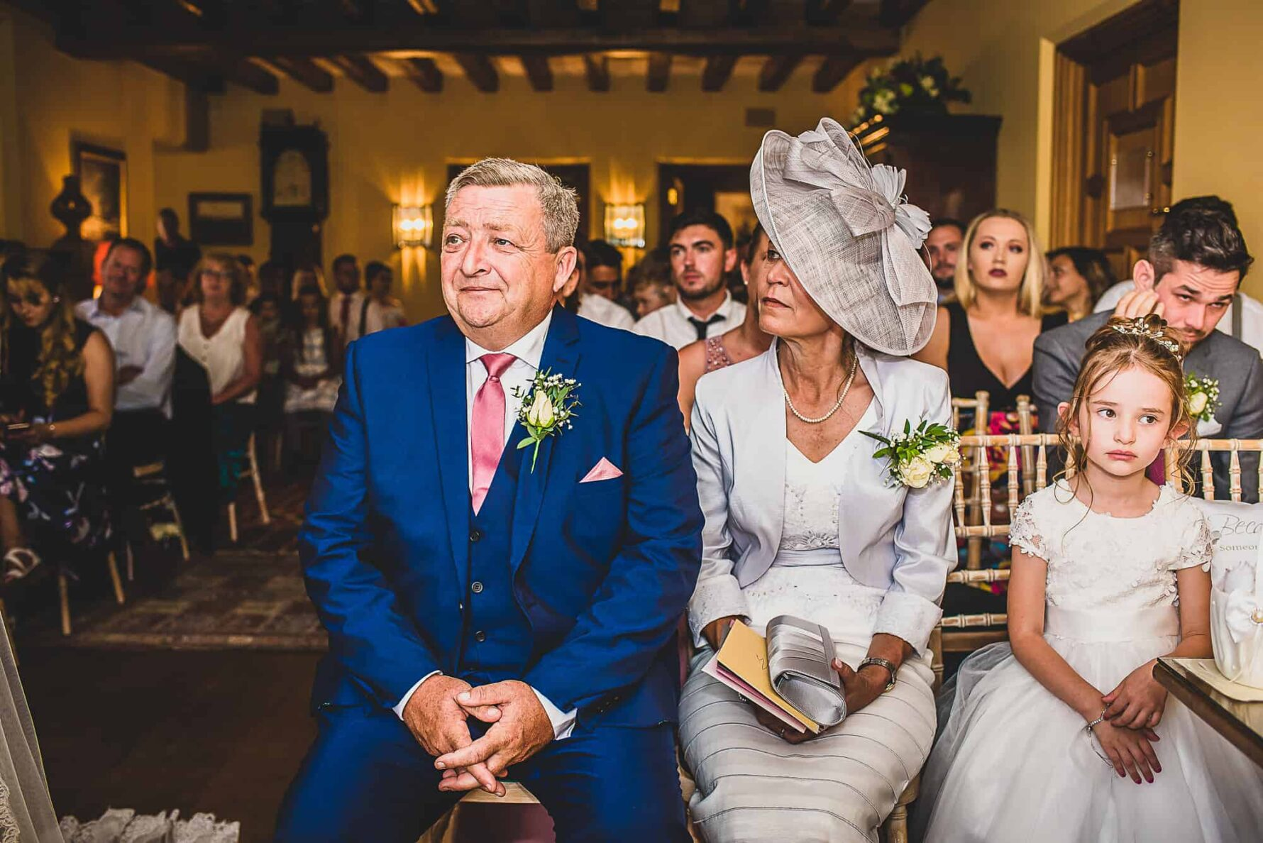 Mother and Father of the Bride look on during ceremony at The Old Hall in Ely