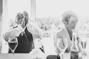 laughter during wedding speeches at The Old Hall in Ely