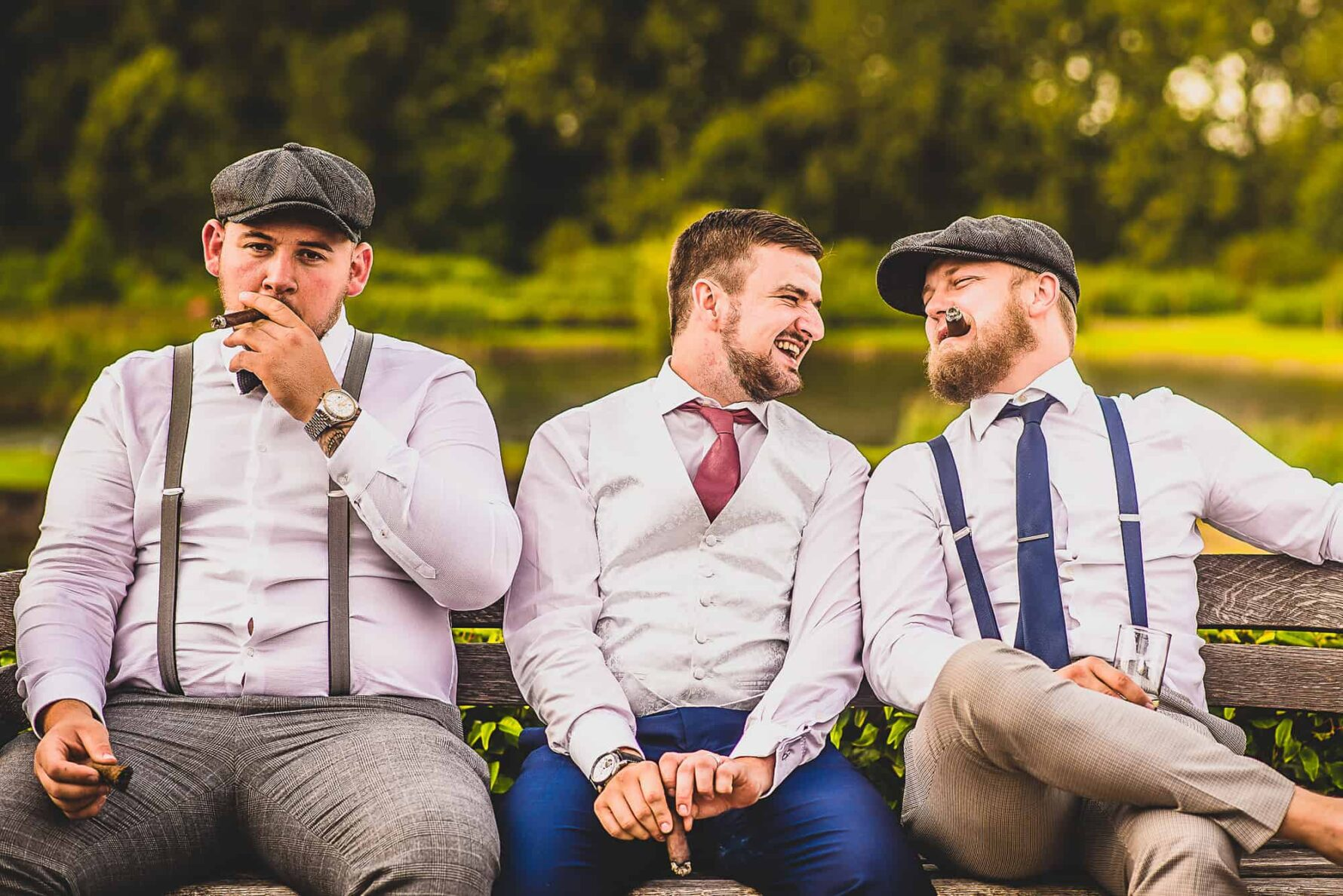 Groomsmen smoking cigars Wedding at The Old Hall Ely