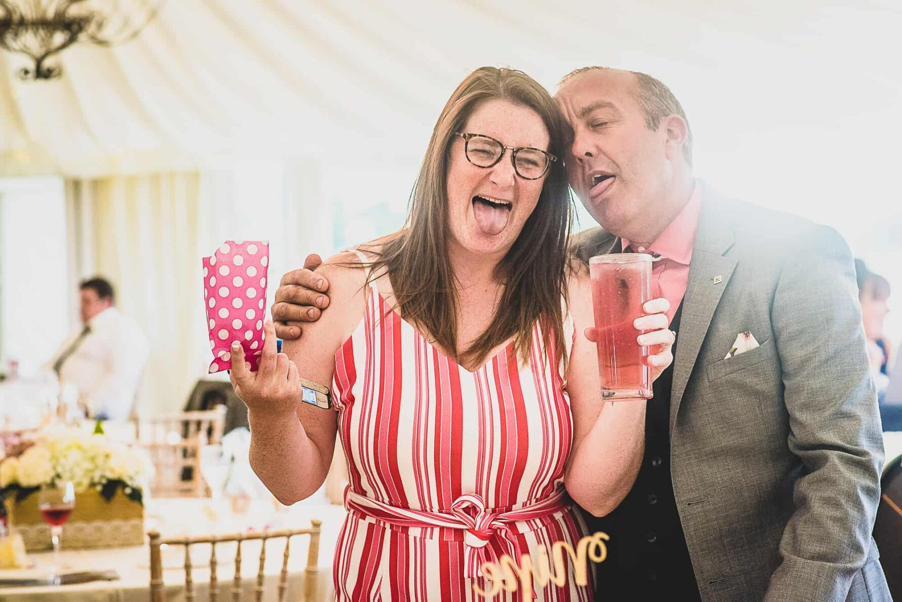 Guest pulling silly faces during Wedding at The Old Hall in Ely