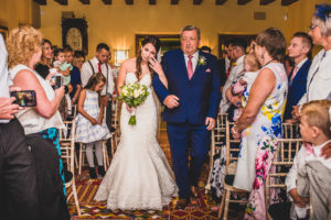 Tearful Bride walks aisle with her Dad. Wedding ceremony at The Old Hall in Ely