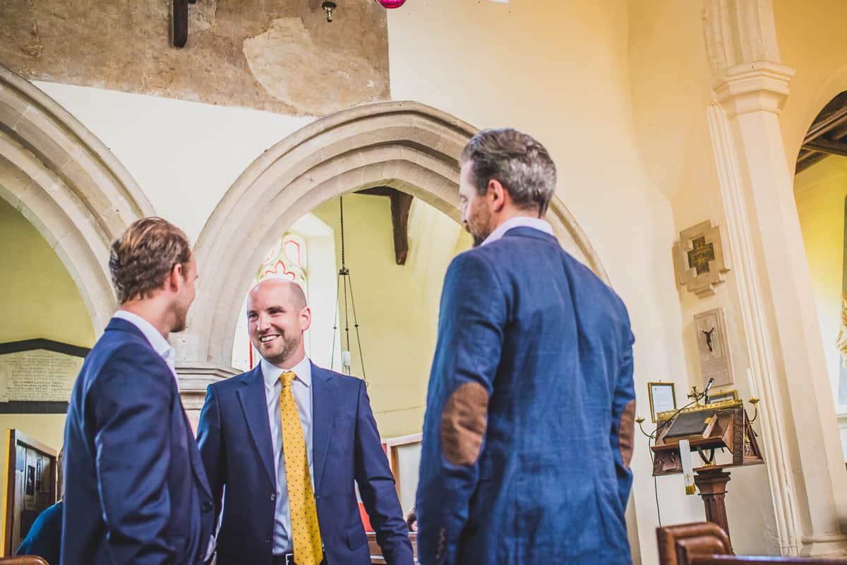 Groom Andrew greets guest at his daughter's Christening before his surprise wedding.