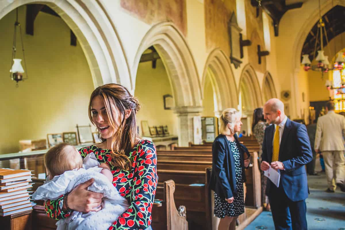 Mother and daughter in church before Suffolk christening