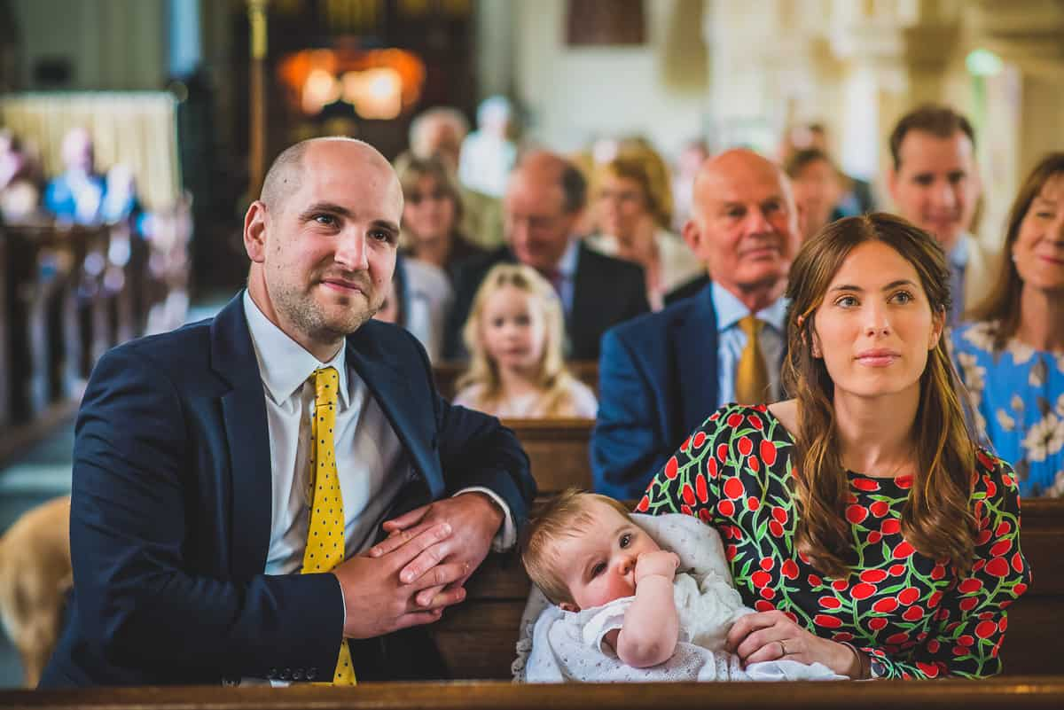 Mum and Dad look on during the Christening service