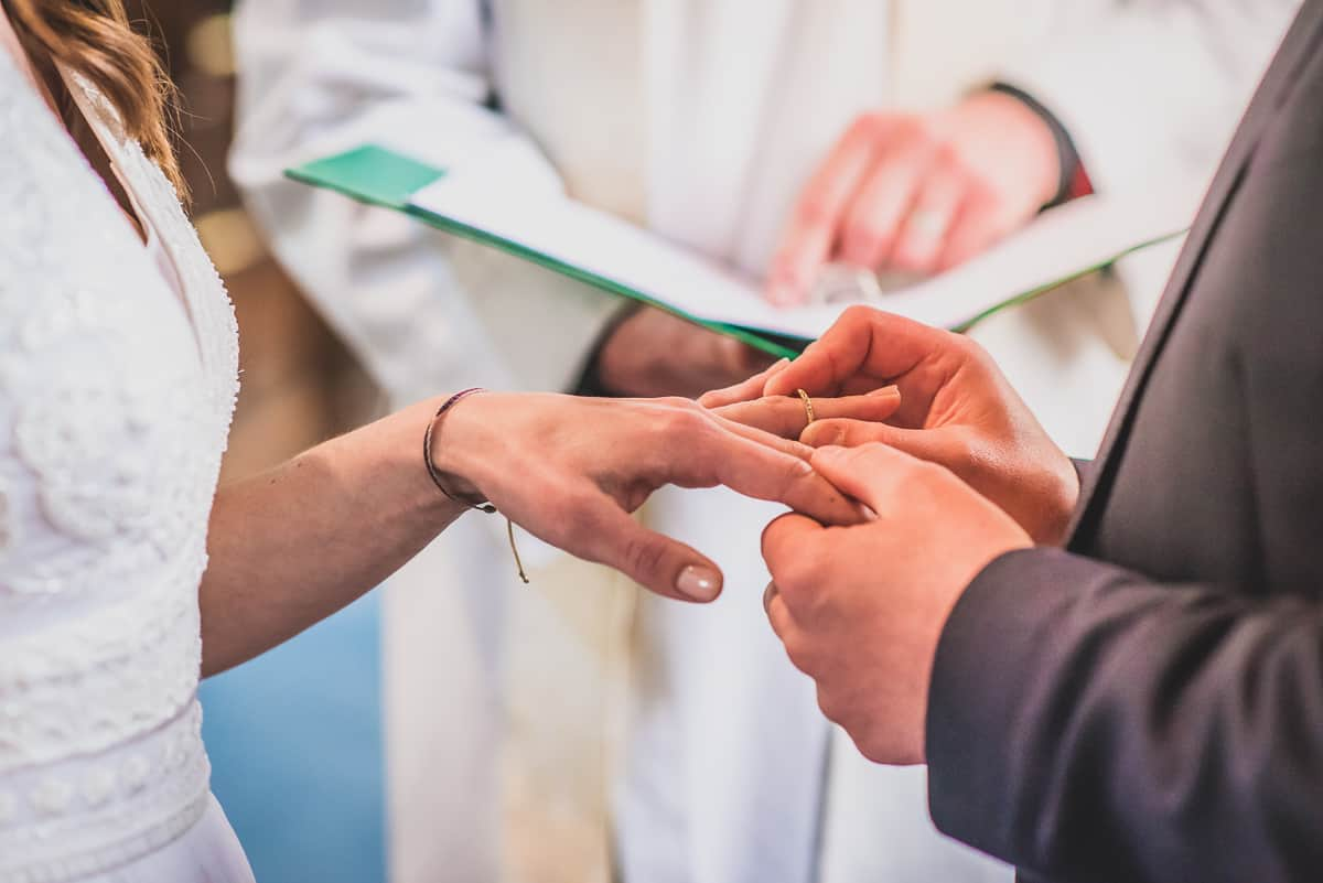 Suffolk couple exchanging rings during their surprise wedding ceremony.