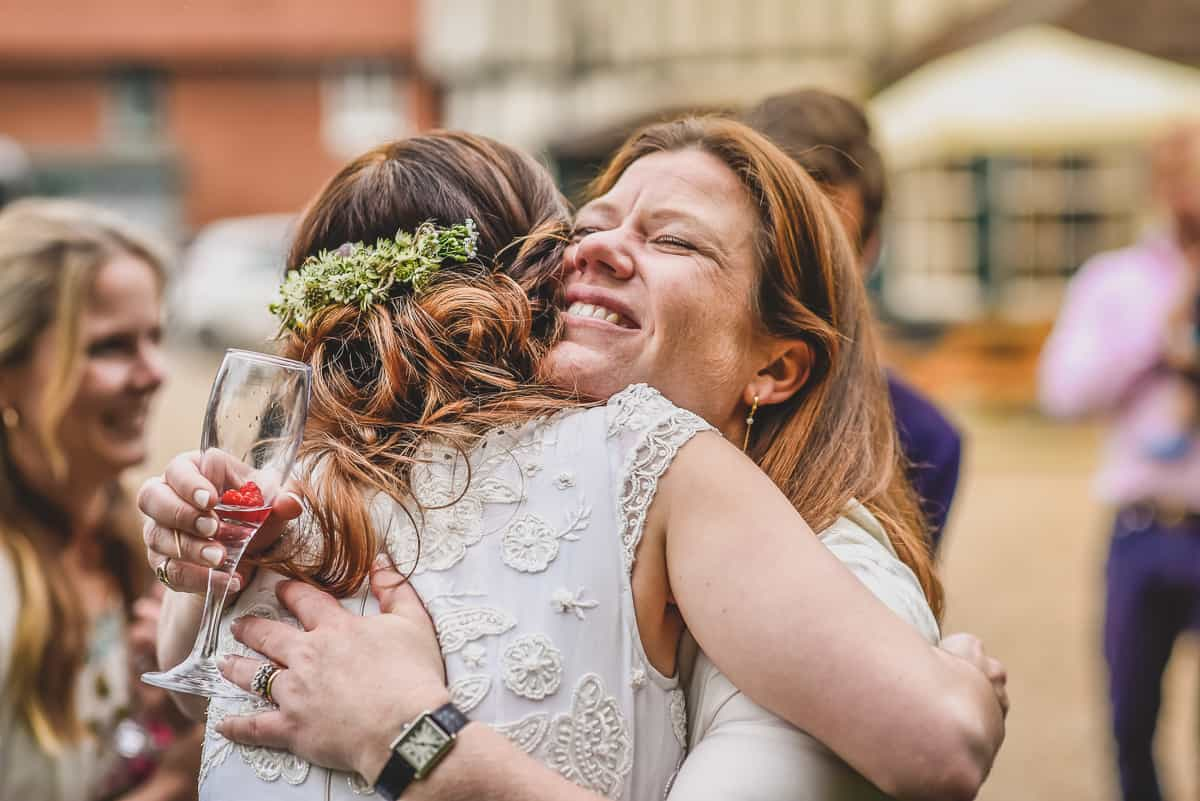 A Bride hugs her guest after her surprise wedding ceremony.