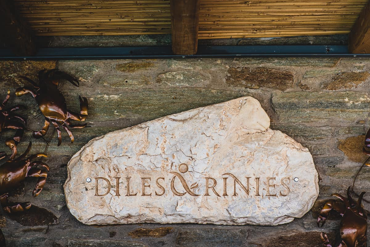Stone sign for Diles & Rinies luxury resort in Tinos