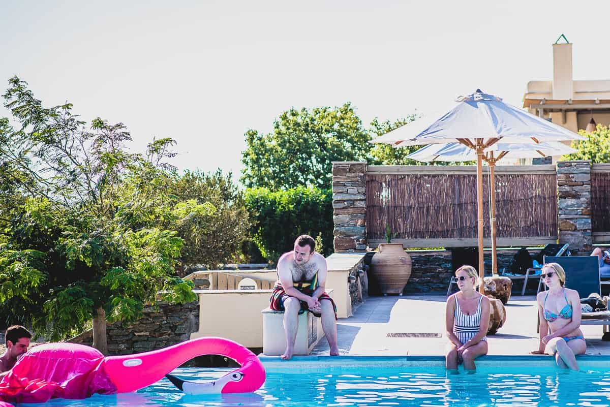 Wedding guests relax by the pool at Diles and Rinies in Tinos