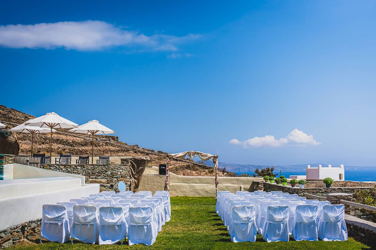 Set up for a destination wedding at Diles and Rinies luxury hotel villas in Tinos. Greek Island Wedding.