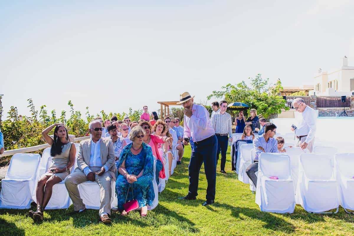 Wedding guests waiting for the outdoor ceremony to commence.