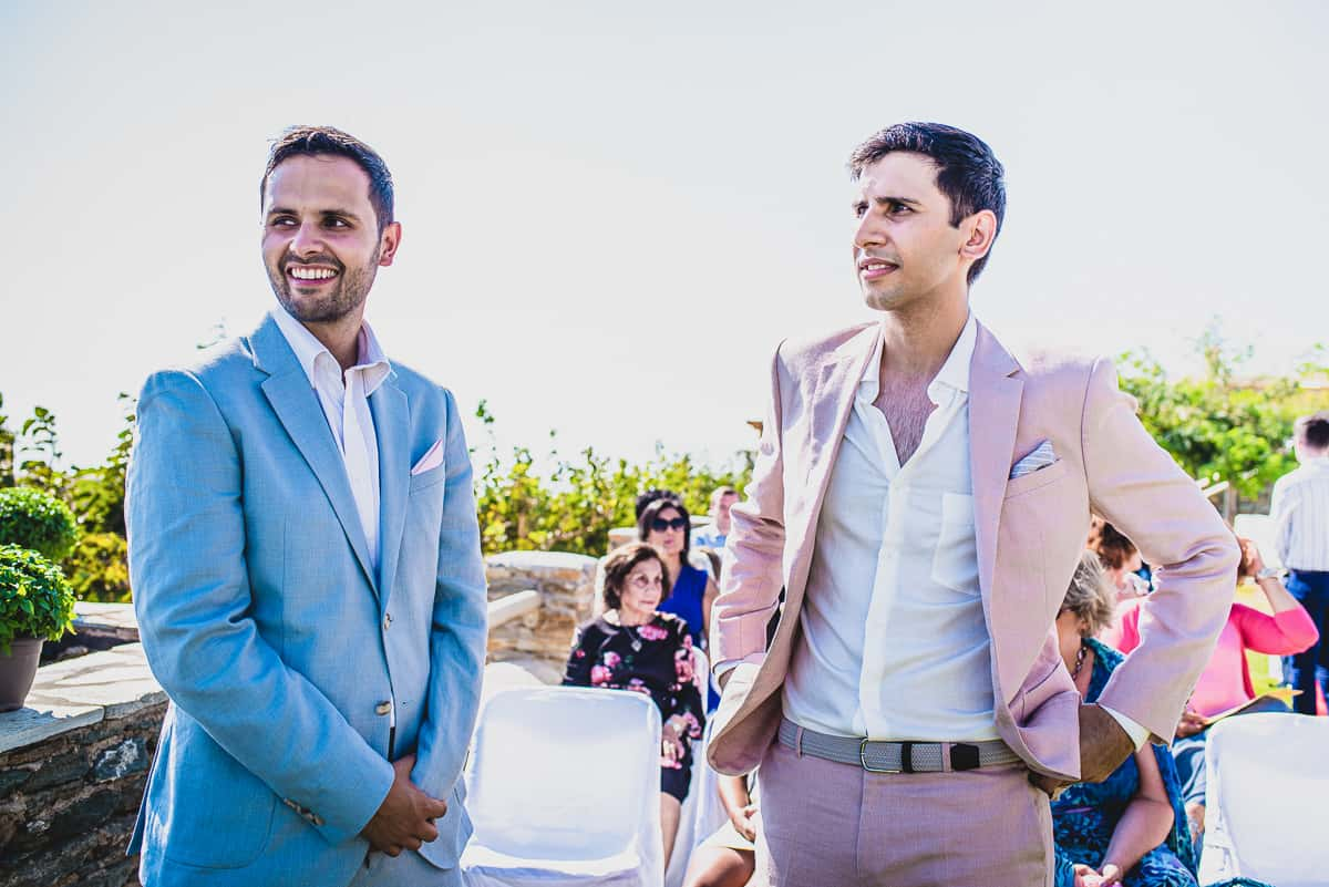Groom and best man wait for the Bride at Wedding in Diles and Rinies luxury Villas resort in TInos.
