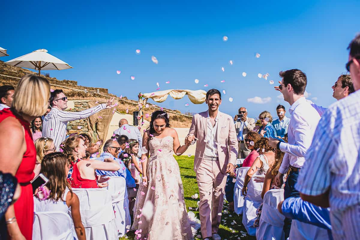Bride and Groom confetti shot at Greece Island destination wedding. Diles and Rinies in Tinos.