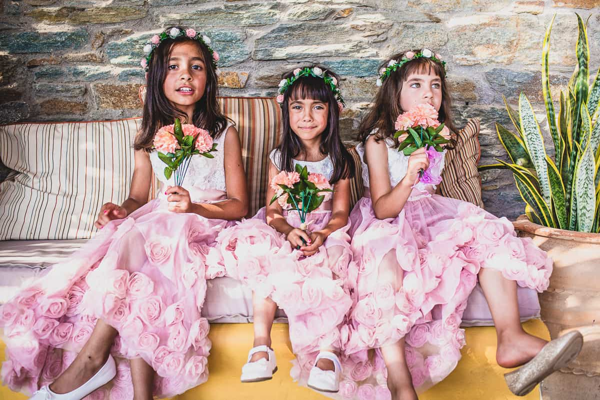 Bridesmaids in pink dress with flowers.