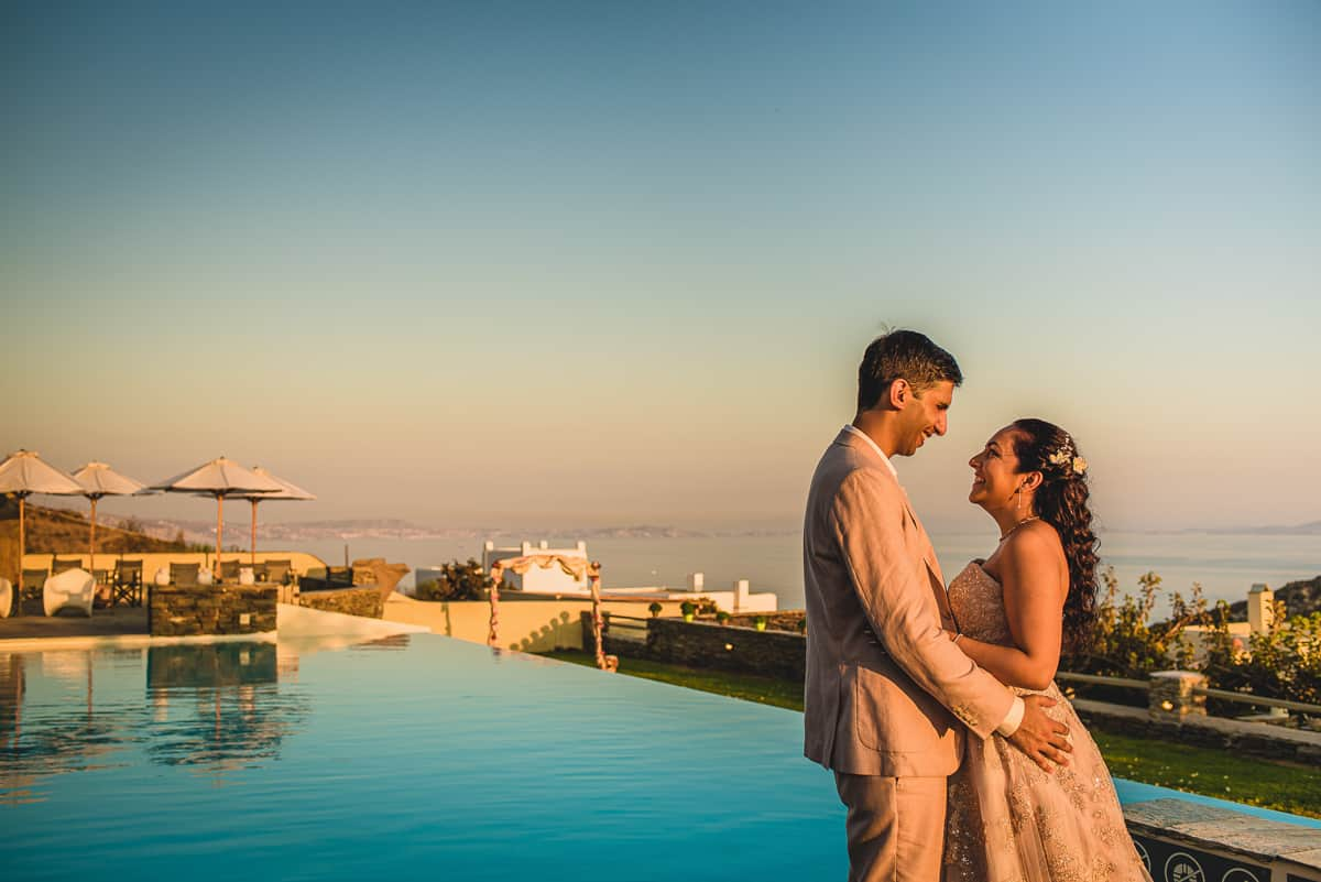 Bride and Groom portrait by pool at Diles and Rinies. Destination Wedding in Greek islands.