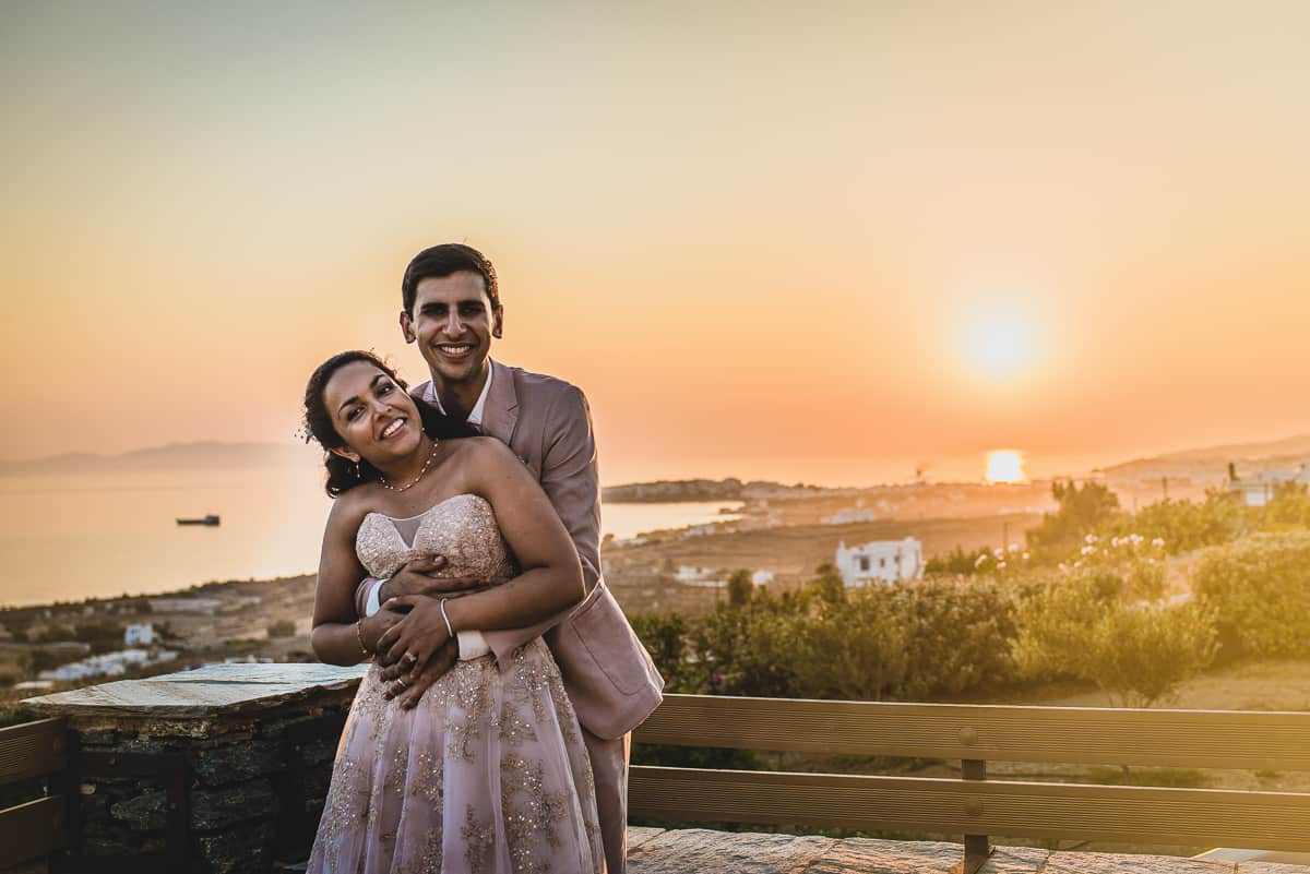 Bride and Groom portrait with view of the bay of Tinos behind.