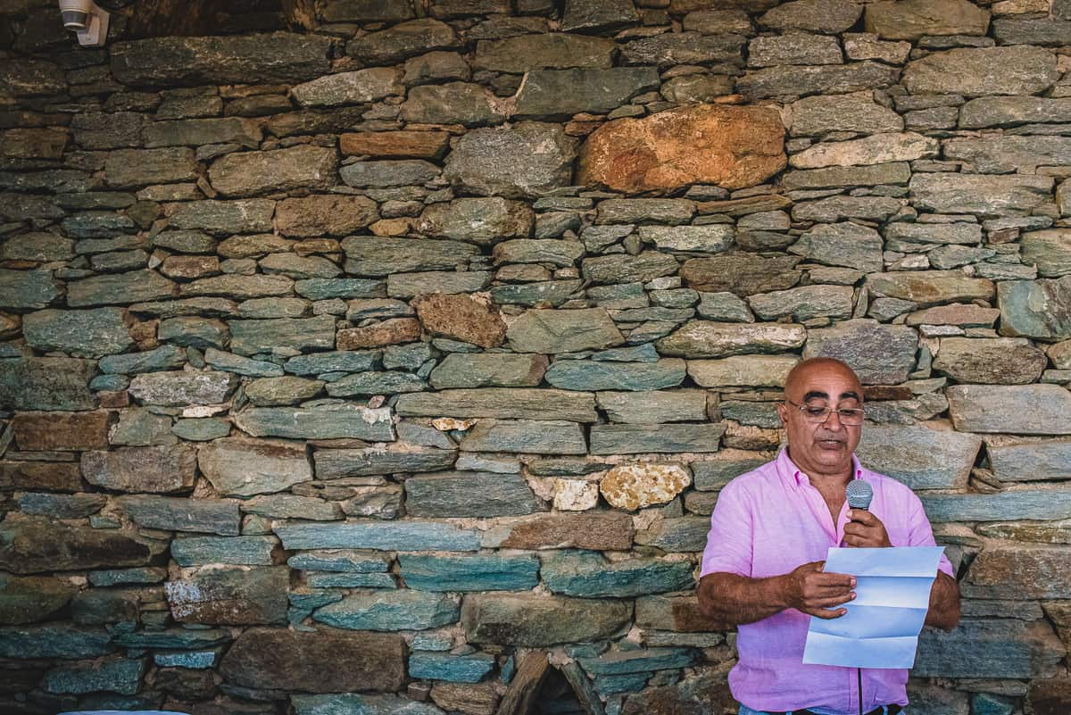 Father of the Bride speech with stone wall behind
