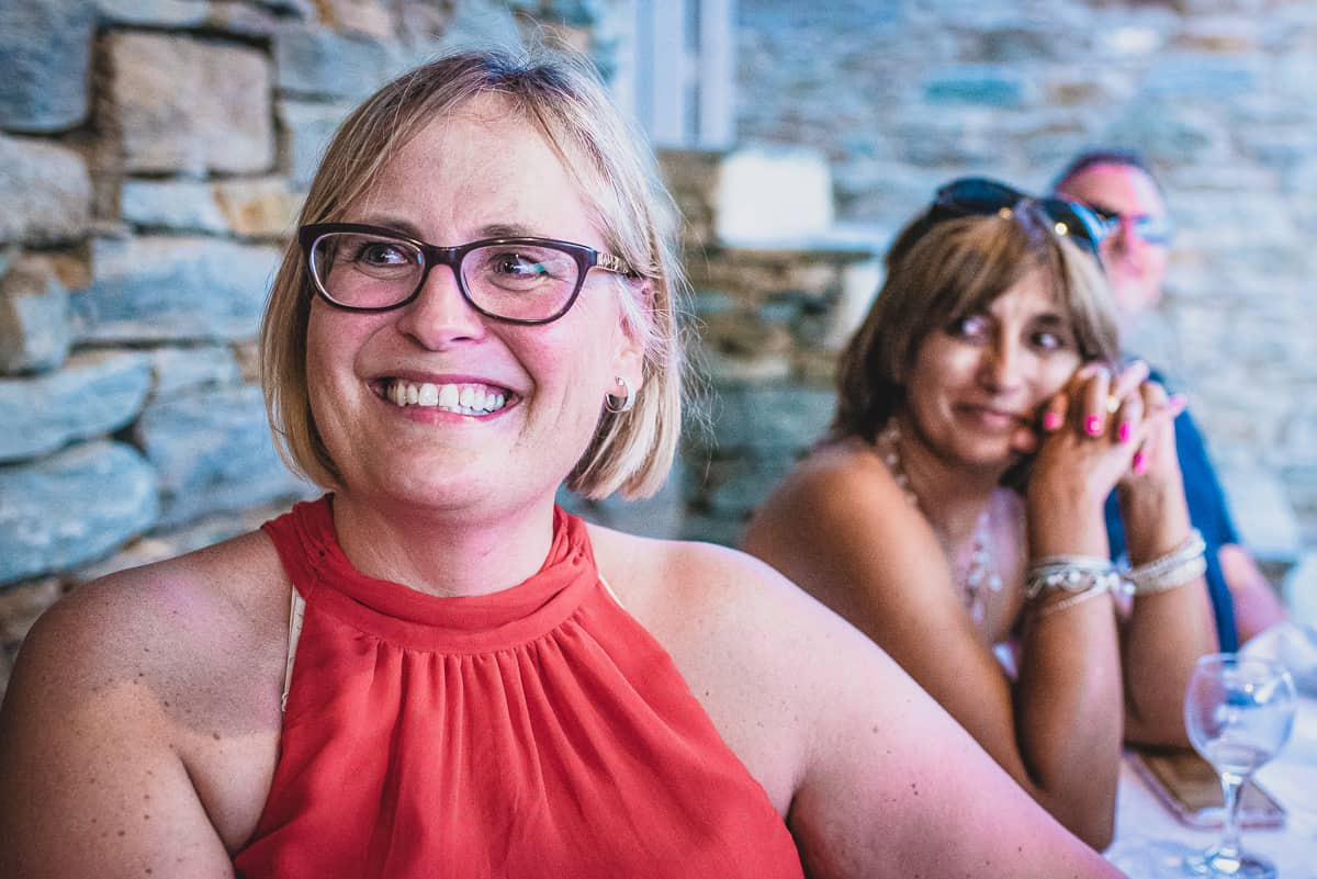 A Smiling guests during the wedding speeches at Greek Island Wedding.