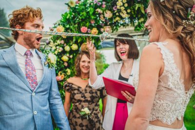 Bride and Groom tying the knot at Cambridge farm wedding
