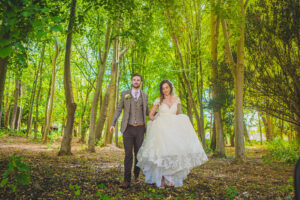 A couple portrait in the woodland area at Barrington Hall Cambridge