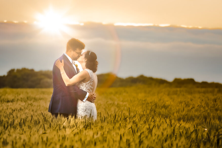 Bride and Groom in the field at Burleigh Hill Farm