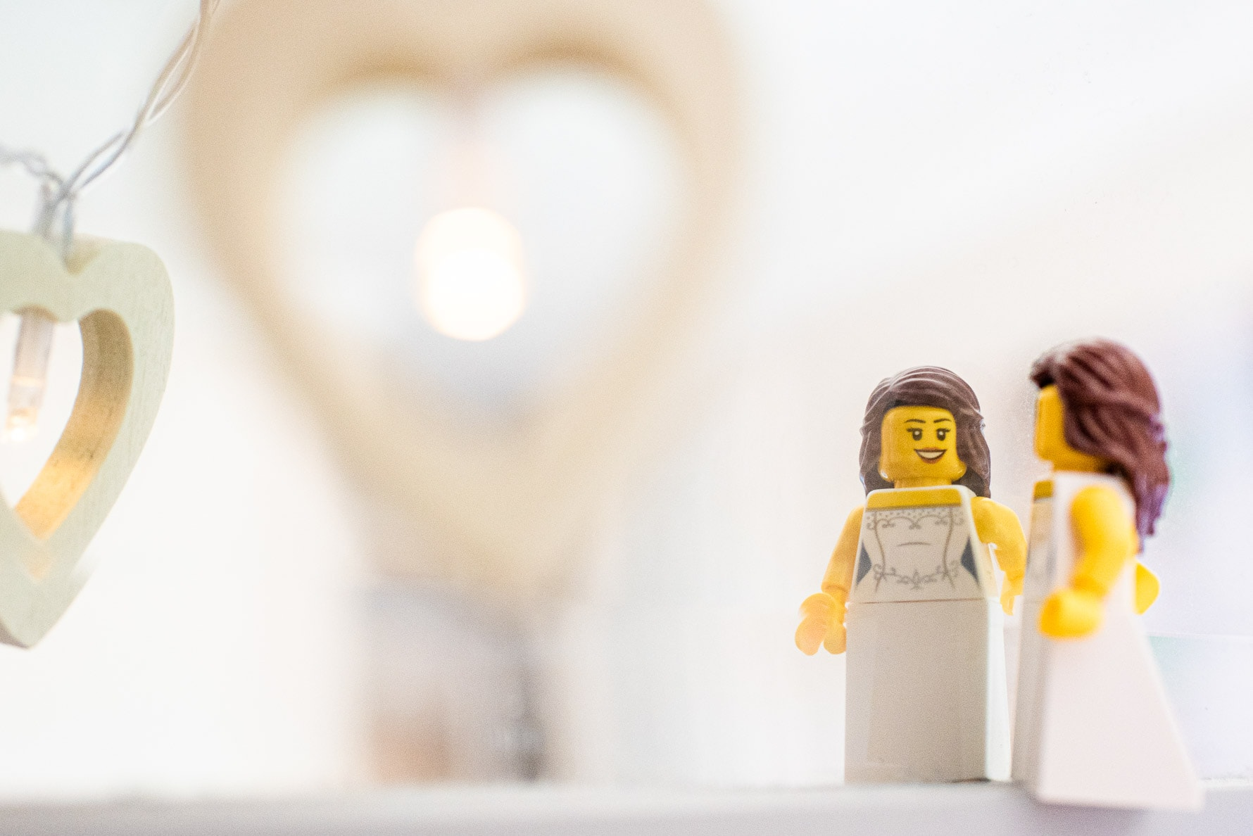 Lego bride checks herself in the mirrorr.