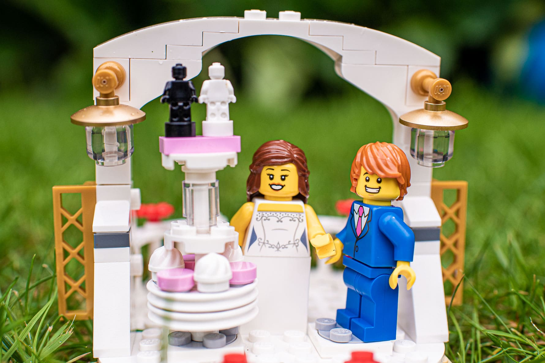 Lego wedding couple prepare to cut their cake