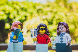 Lego wedding guests enjoying drinks on the lawn
