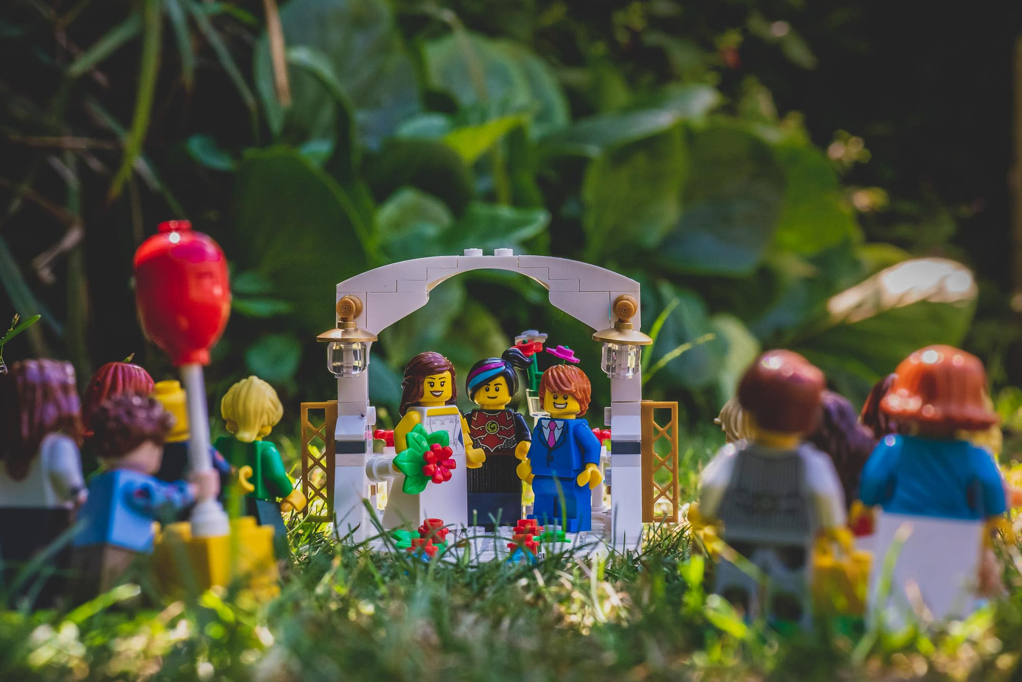 Lego Bride and Groom look back and smile at their wedding guests