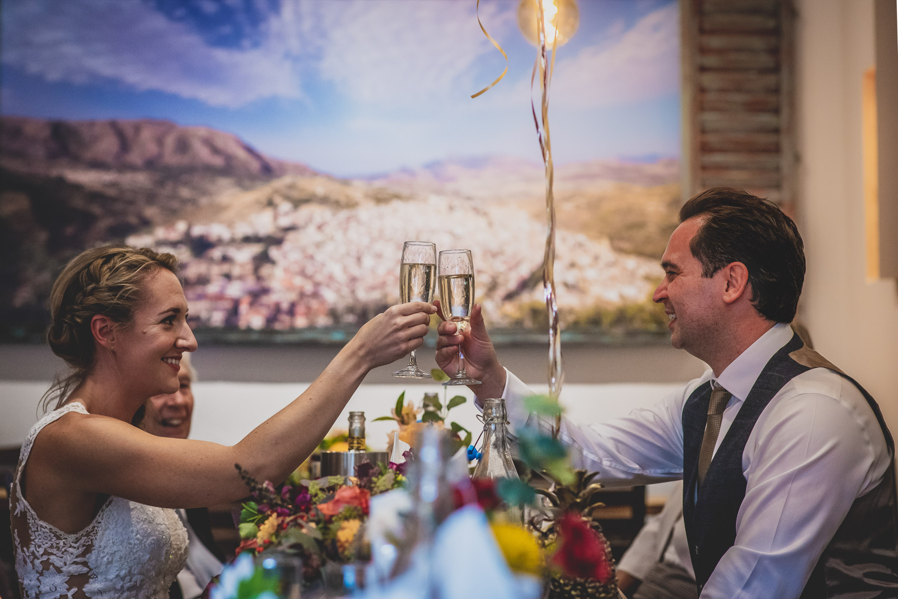A couple toast each other at their small and intimate wedding in St Albans. 5 Great reasons to have a photographer at a small wedding.