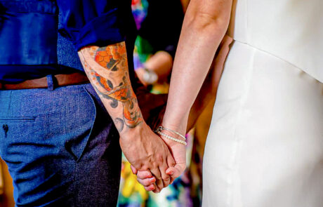 Bride and groom holing hands during Cambridge Wedding ceremony