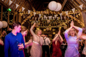 Guests partying in The Thatch Barn Wedding Venue near St Neots