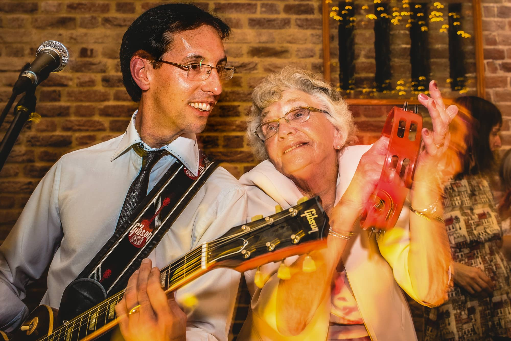 Groom's Nan joins the band onstage at wedding reception in Cambridge